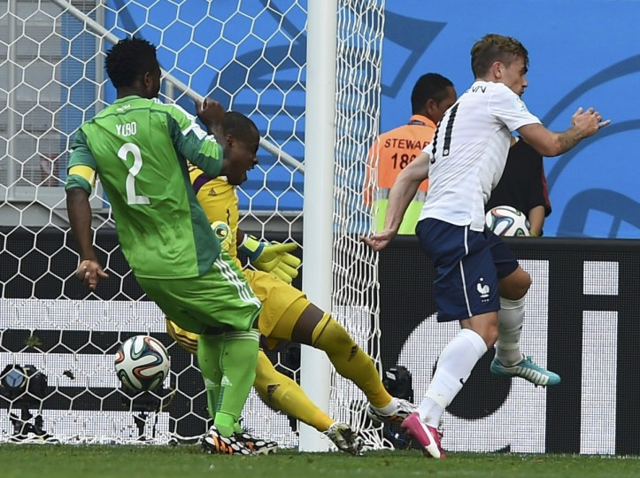Nigeria's Joseph Yobo kicks the ball and scores an own goal beside teammate Vincent Enyeama (back C) and France's Antoine Griezmann (R) during their 2014 World Cup round of 16 game at the Brasilia national stadium in Brasilia June 30, 2014. (Dylan Martinez/Reuters)