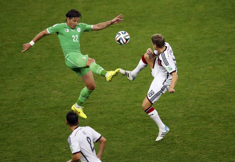 Algeria's Mehdi Mostefa fights for the ball with Germany's Toni Kroos during their 2014 World Cup round of 16 game at the Beira Rio stadium in Porto Alegre June 30, 2014. (Leonhard Foeger/Reuters)