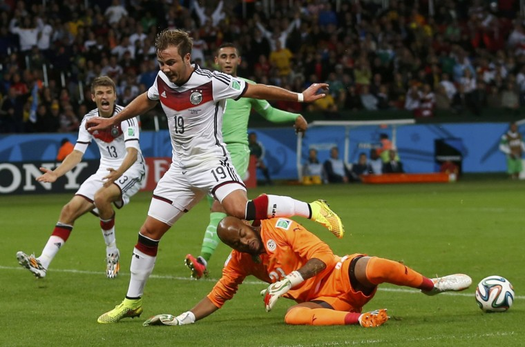 Algeria's goalkeeper Rais Mbolhi saves the ball beside Germany's Mario Goetze (C) and Thomas Mueller (L) during their 2014 World Cup round of 16 game at the Beira Rio stadium in Porto Alegre June 30, 2014. (Edgard Garrido/Reuters)