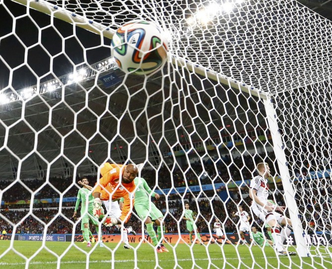 Germany's Andre Schuerrle (9) scores past Algeria's goalkeeper Rais Mbolhi during their 2014 World Cup round of 16 game at the Beira Rio stadium in Porto Alegre June 30, 2014. (Stefano Rellandini/Reuters)