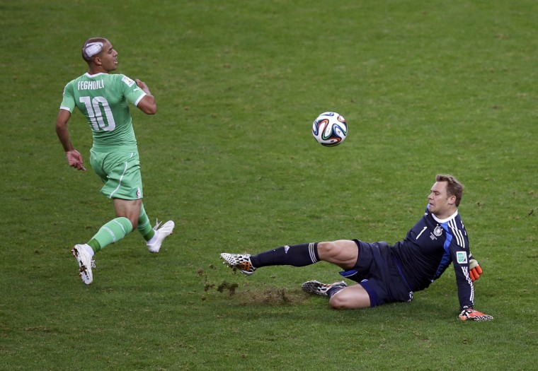Germany's goalkeeper Manuel Neuer clears the ball from Algeria's Sofiane Feghouli during their 2014 World Cup round of 16 game at the Beira Rio stadium in Porto Alegre June 30, 2014. (Leonhard Foeger/Reuters)