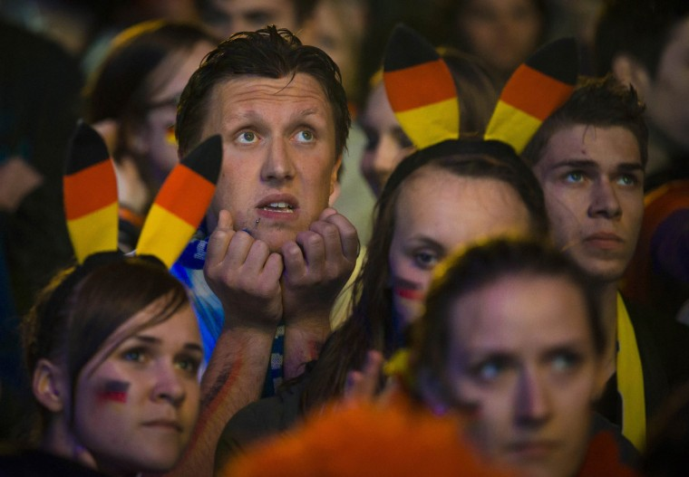 People watch Germany play against Algeria during their 2014 World Cup round of 16 game, at the Fanmeile public viewing arena in Berlin June 30, 2014. (Thomas Peter/Reuters)