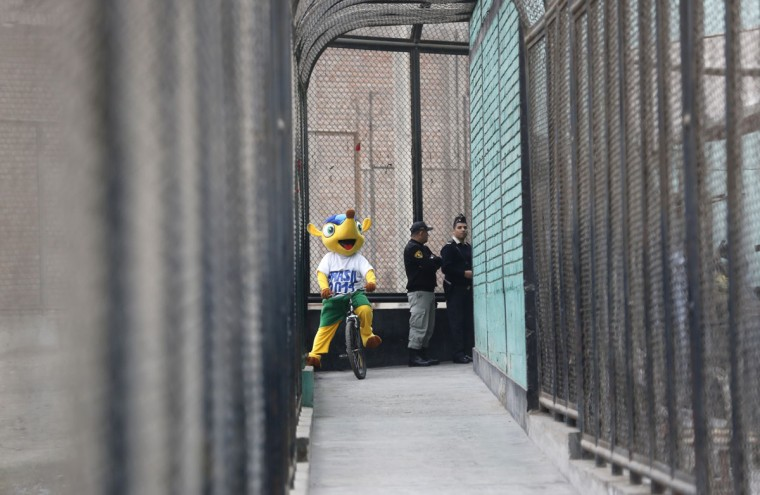 A prisoner dressed as Fuleco, the mascot for the 2014 World Cup, participates in the opening ceremony of their own version of the tournament at the Castro-Castro prison in Lima, June 2, 2014. According to a press release from the prison, about 300 inmates at the Castro-Castro penitentiary are participating in the two-week tournament, which is being held in order to encourage the adoption of sports within the prison population. REUTERS/ Mariana Bazo