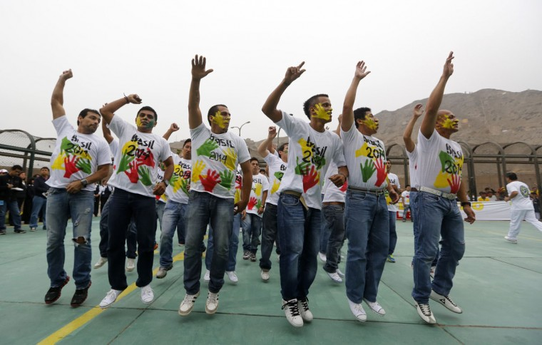 Prisoners participate in the opening ceremony of their own version of the 2014 World Cup at the Castro-Castro prison in Lima, June 2, 2014. According to a press release from the prison, about 300 inmates at the Castro-Castro penitentiary are participating in the two-week tournament, which is being held in order to encourage the adoption of sports within the prison population. REUTERS/ Mariana Bazo