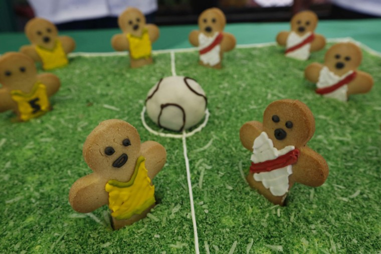 A cake made by the prisoners is displayed as they participate in the opening ceremony of their own version of the 2014 World Cup at the Castro-Castro prison in Lima, June 2, 2014. According to a press release from the prison, about 300 inmates at the Castro-Castro penitentiary are participating in the two-week tournament, which is being held in order to encourage the adoption of sports within the prison population. REUTERS/Mariana Bazo