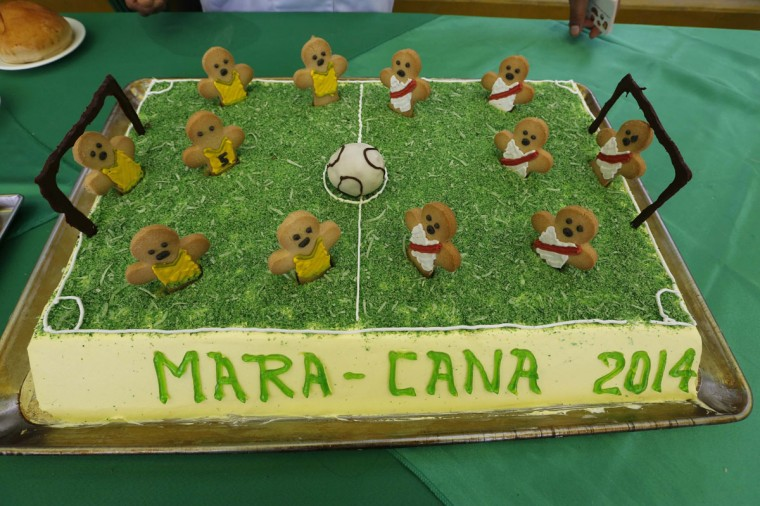"""A cake made by the prisoners is displayed as they participate in the opening ceremony of their own version of the 2014 World Cup at the Castro-Castro prison in Lima, June 2, 2014. The word """"Cana"""" written on the cake means """"Prison"""" in local slang. According to a press release from the prison, about 300 inmates at the Castro-Castro penitentiary are participating in the two-week tournament, which is being held in order to encourage the adoption of sports within the prison population. REUTERS/Mariana Bazo"""