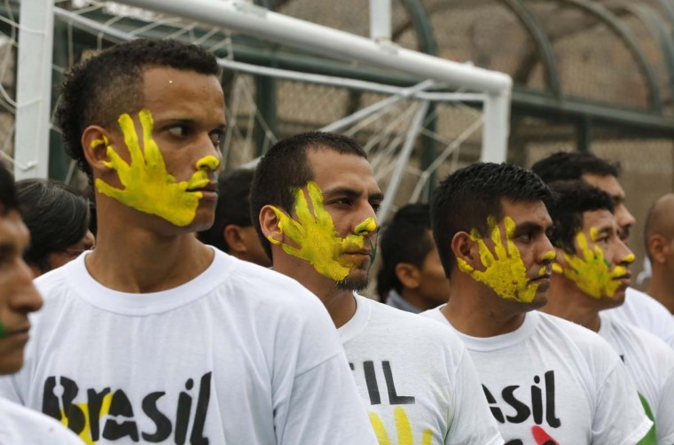 Prisoners participate in the opening ceremony of their own version of the 2014 World Cup at the Castro-Castro prison in Lima, June 2. According to a press release from the prison, about 300 inmates at the Castro-Castro penitentiary are participating in the two-week tournament, which is being held in order to encourage the adoption of sports within the prison population.   || PHOTO CREDIT:  MARIANA BAZO  - REUTERS