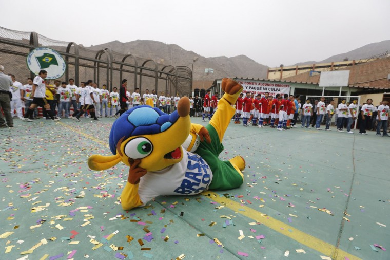 A prisoner dressed as Fuleco, the mascot for the 2014 World Cup, performs in the opening ceremony of their own version of the tournament at the Castro-Castro prison in Lima, June 2, 2014. According to a press release from the prison, about 300 inmates at the Castro-Castro penitentiary are participating in the two-week tournament, which is being held in order to encourage the adoption of sports within the prison population. REUTERS/ Mariana Bazo