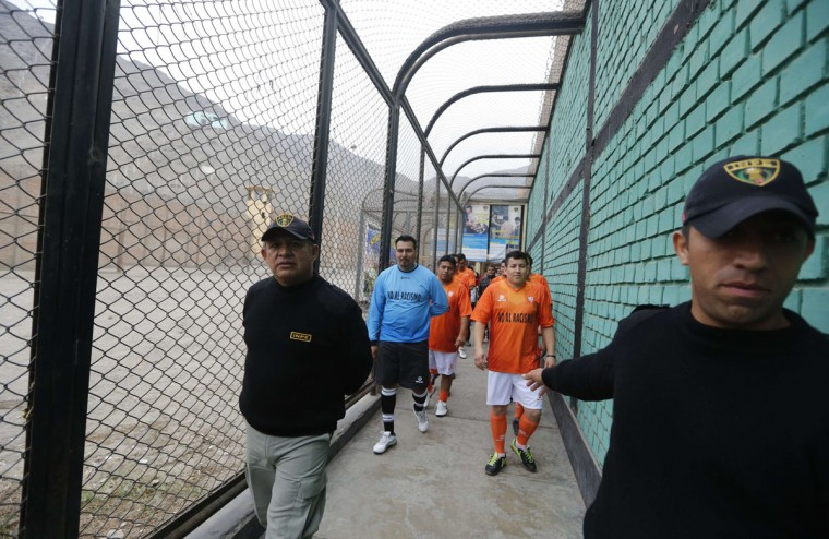 Prisoners, wearing jerseys in the colours of the Netherlands national soccer team, participate in the opening ceremony of their own version of the 2014 World Cup at the Castro-Castro prison in Lima, June 2, 2014. According to a press release from the prison, about 300 inmates at the Castro-Castro penitentiary are participating in the two-week tournament, which is being held in order to encourage the adoption of sports within the prison population. REUTERS/ Mariana Bazo