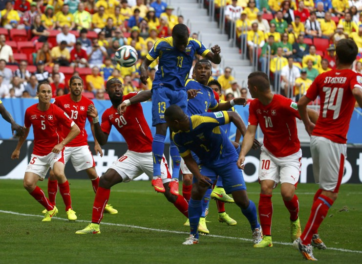 Ecuador's Enner Valencia (top C) scores a goal against Switzerland during their 2014 World Cup Group E soccer match at the Brasilia national stadium in Brasilia June 15, 2014. (Paul Hanna/Reuters)