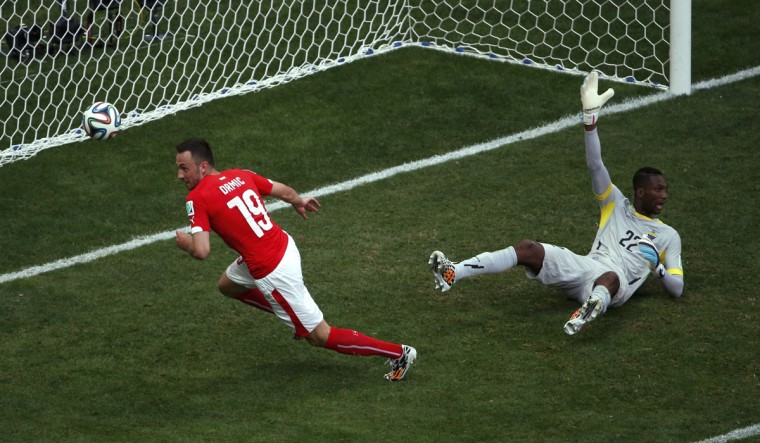 Switzerland's Josip Drmic shoots past Ecuador's goalkeeper Alexander Dominguez during the 2014 World Cup Group E soccer match between Switzerland and Ecuador at the Brasilia national stadium in Brasilia, June 15, 2014. The goal was disallowed. (David Gray/Reuters)