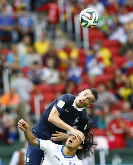 France's Mathieu Debuchy fights with Roger Espinoza of Honduras for the ball during their 2014 World Cup Group E soccer match at the Beira-Rio stadium in Porto Alegre June 15, 2014. (Murad Sezer/Reuters)