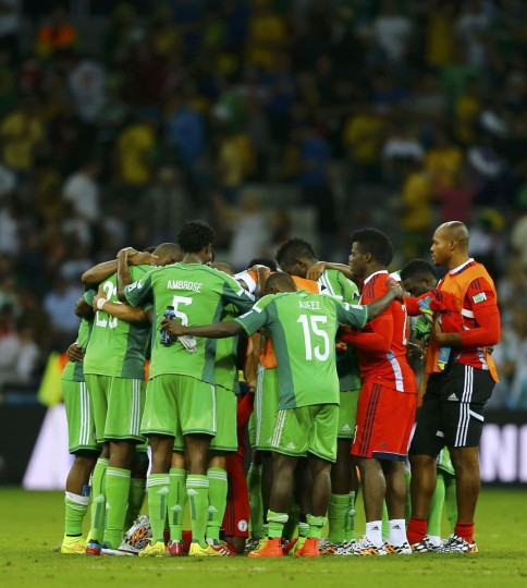 Nigeria player huddle at the end of the 2014 World Cup Group F soccer match between Iran and Nigeria at the Baixada arena in Curitiba on June 16, 2014. (REUTERS/Ivan Alvarado)