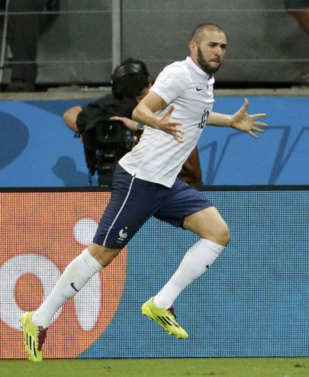 France's Karim Benzema celebrates after scoring their fourth goal against Switzerland during their 2014 World Cup Group E soccer match at the Fonte Nova arena in Salvador June 20, 2014. (Jorge Silva/Reuters)