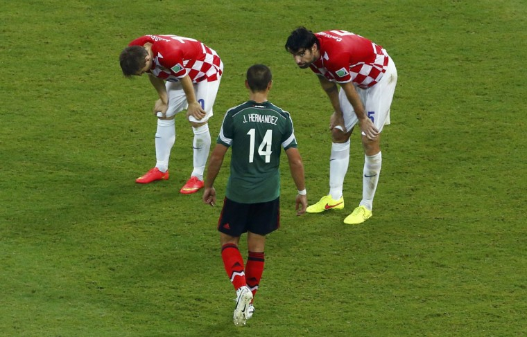 Croatia's Luka Modric (left) and Vedran Corluka (right) react near Mexico's Javier Hernandez after their 2014 World Cup Group A soccer match at the Pernambuco Arena in Recife on June 23, 2014. (REUTERS/Ruben Sprich)