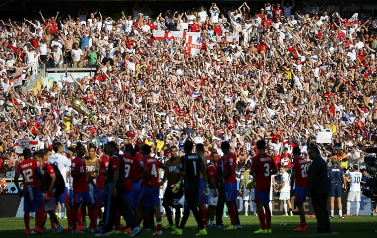 England's fans wave at the end of their 2014 World Cup Group D soccer match against Costa Rica at the Mineirao stadium in Belo Horizonte June 24, 2014. (REUTERS/Murad Sezer)