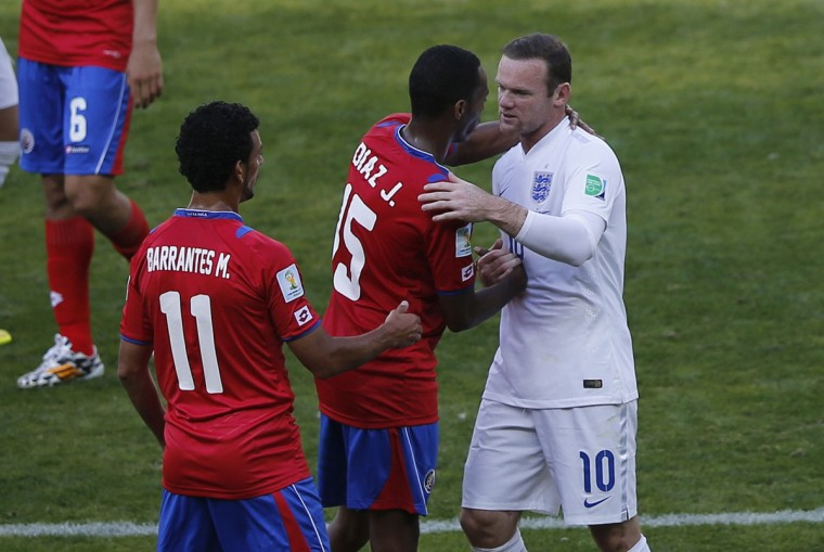 From left, Costa Rica's Michael Barrantes and Junior Diaz shake hands with England's Wayne Rooney after their 2014 World Cup Group D soccer match at the Mineirao stadium in Belo Horizonte on June 24, 2014. (REUTERS/Leonhard Foeger)
