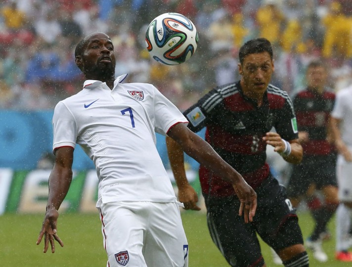 DaMarcus Beasley of the U.S. (L) fights for the ball with Germany's Mesut Ozil during their 2014 World Cup Group G soccer match at the Pernambuco arena in Recife June 26, 2014. (Tony Gentile/Reuters)