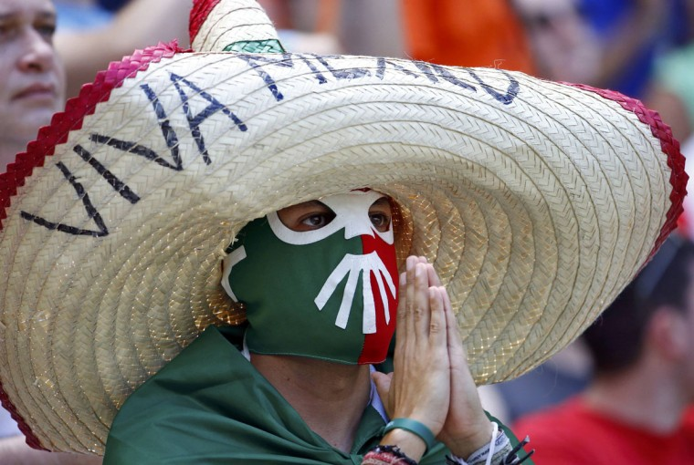 A fan of Mexico waits for the start of the 2014 World Cup round of 16 game between Netherlands and Mexico at the Castelao arena in Fortaleza June 29, 2014. (Dominic Ebenbichler/Reuters)