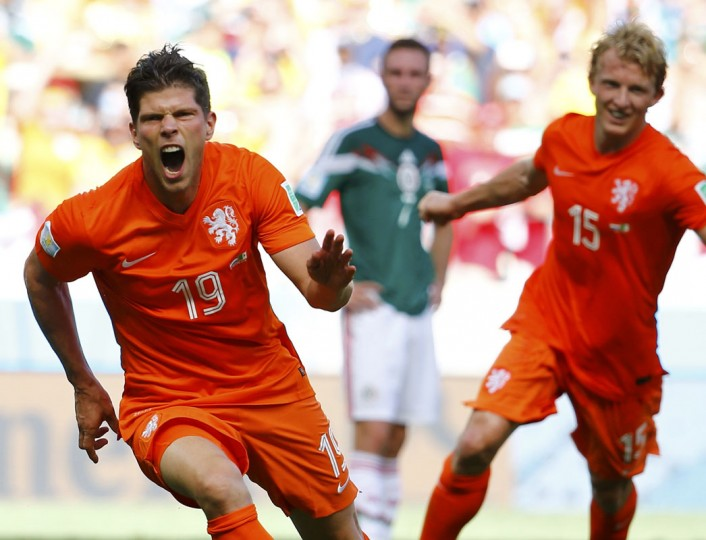 Klaas-Jan Huntelaar (L) and Dirk Kuyt of the Netherlands celebrate Huntelaar's goal during their 2014 World Cup round of 16 game against Mexico at the Castelao arena in Fortaleza June 29, 2014. (Dominic Ebenbichler/Reuters)