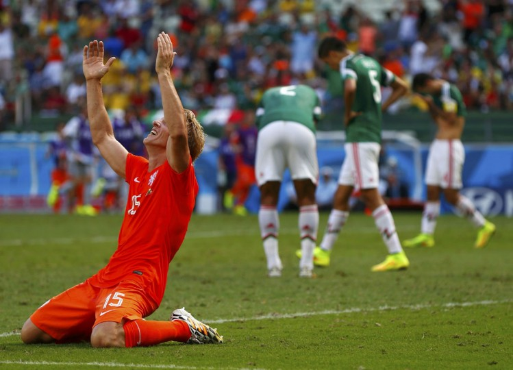 Dirk Kuyt of the Netherlands celebrates after team mate Wesley Sneijder scored a goal during their 2014 World Cup round of 16 game against Mexico at the Castelao arena in Fortaleza June 29, 2014. (Eddie Keogh/Reuters)