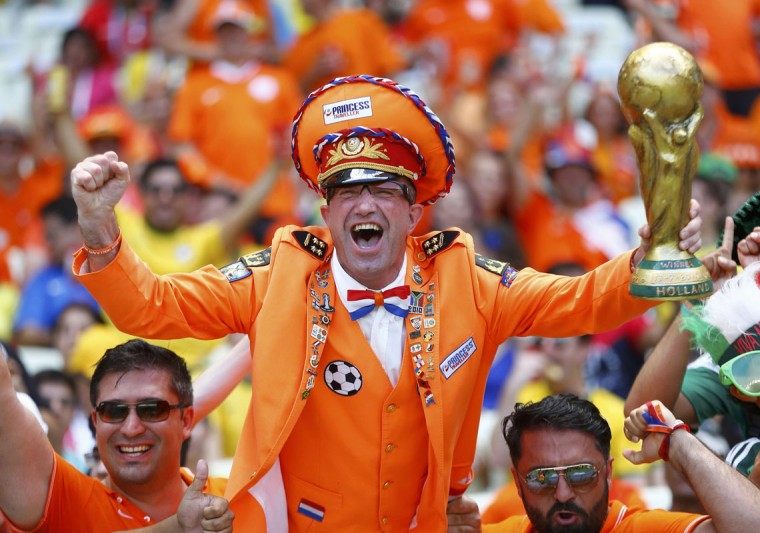 A fan of the Netherlands holding a mock World Cup trophy cheers before the start of the 2014 World Cup round of 16 game between Netherlands and Mexico at the Castelao arena in Fortaleza June 29, 2014. (Dominic Ebenbichler/Reuters)