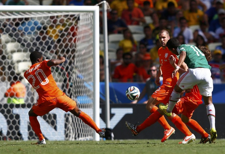 Mexico's Giovani Dos Santos (10) scores a goal during their 2014 World Cup round of 16 game against the Netherlands at the Castelao arena in Fortaleza June 29, 2014. (Eddie Keogh/Reuters)