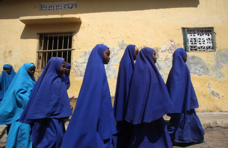 Somali student walk to attend classes at Bustaale Primary and Secondary school in capital Mogadishu June 18, 2014. (Ismail Taxta/Reuters)