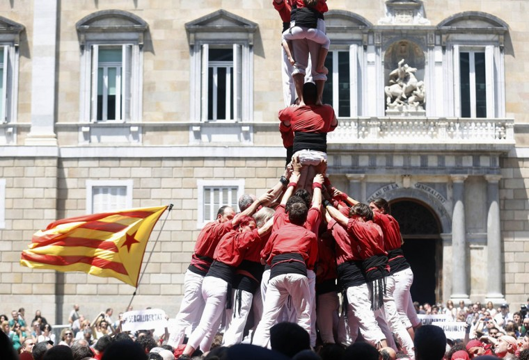 "Castellers de Barcelona form a human tower during a demonstration, ""Human towers for democracy: Catalans want to vote"", at Sant Jaume square in Barcelona June 8, 2014. (Albert Gea/Reuters)"