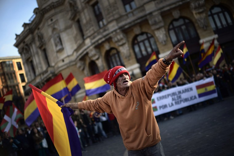 An anti-royalist protester shouts as he waves a republican flag during a demonstration in Bilbao June 2, 2014. Spain's King Juan Carlos said on Monday he would abdicate in favour of his son Prince Felipe, aiming to revive the scandal-hit monarchy at a time of economic hardship and growing discontent with the wider political elite. (Vincent West/Reuters)