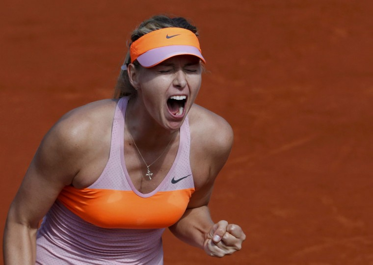 Maria Sharapova of Russia reacts during her women's semi-final match against Eugenie Bouchard of Canada at the French Open tennis tournament at the Roland Garros stadium in Paris June 5, 2014. (Gonzalo Fuentes/Reuters)
