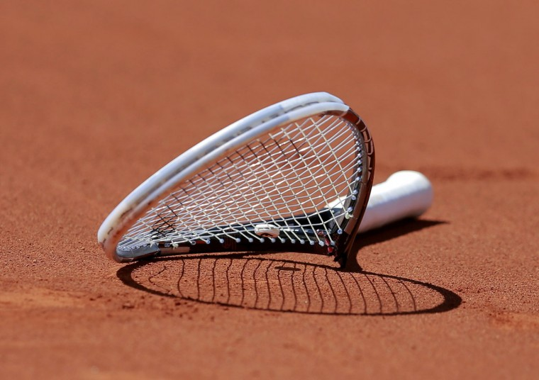 The broken racket of Novak Djokovic of Serbia is seen on the court after he smashed it during his men's semi-final match against Ernests Gulbis of Latvia at the French Open tennis tournament at the Roland Garros stadium in Paris June 6, 2014. (Vincent Kessler/Reuters)