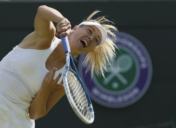 Maria Sharapova of Russia serves to Samantha Murray of Britain in their women's singles tennis match at the Wimbledon Tennis Championships, in London June 24, 2014. (REUTERS/Stefan Wermuth)