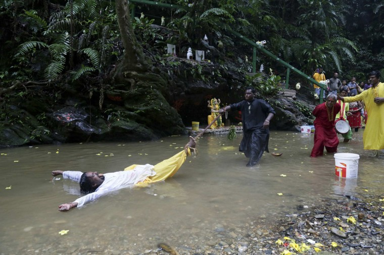 Pilgrims drag a devotee by a rope in the Marianne River during the Ganga Dhaaraa festival at Blanchisseuse on Trinidad's north coast June 8, 2014. Pilgrims all over the country and abroad have been gathering for the Hindu festival, also known as the oldest river festival, which commemorates the coming down of goddess Ganga to earth. (Andrea De Silva/Reuters)