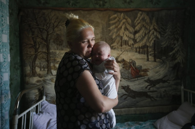 A mother and child who have fled from fighting in Slaviansk, stand in their temporary accommodation in the town of Nizhnaya Krinka in eastern Ukraine. Ukrainian government forces battled separatists with artillery and automatic weapons on Wednesday as fighting raged for a second straight day in and around the eastern town of Slaviansk, forcing many frightened residents to flee. (Maxim Zmeyev/Reuters)