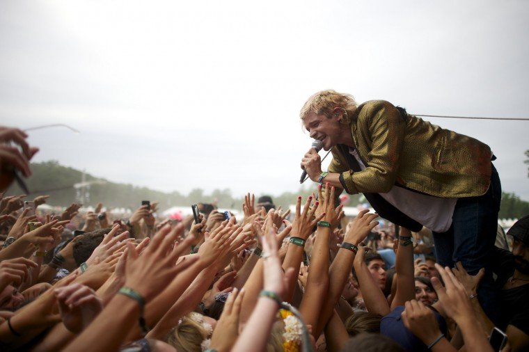 Vocalist Christian Zucconi of the band Grouplove greets fans during a performance at the Firefly Music Festival in Dover June 21, 2014. The four-day festival is set at the 105 acre grounds on the Dover International Speedway where many well known bands will perform. (Mark Makela/Reuters)