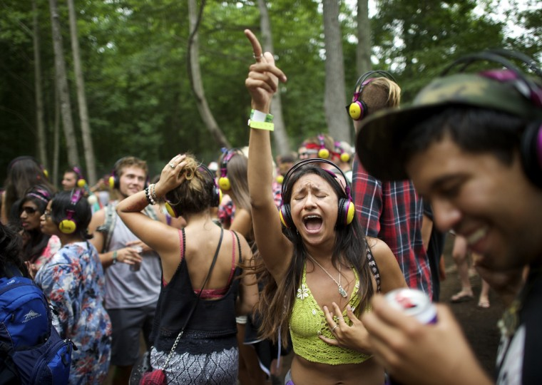 Revelers dance at the silent disco during the Firefly Music Festival in Dover, June 21, 2014. The four-day festival is set at the 105 acre grounds on the Dover International Speedway where many well known bands will perform. (Mark Makela/Reuters)