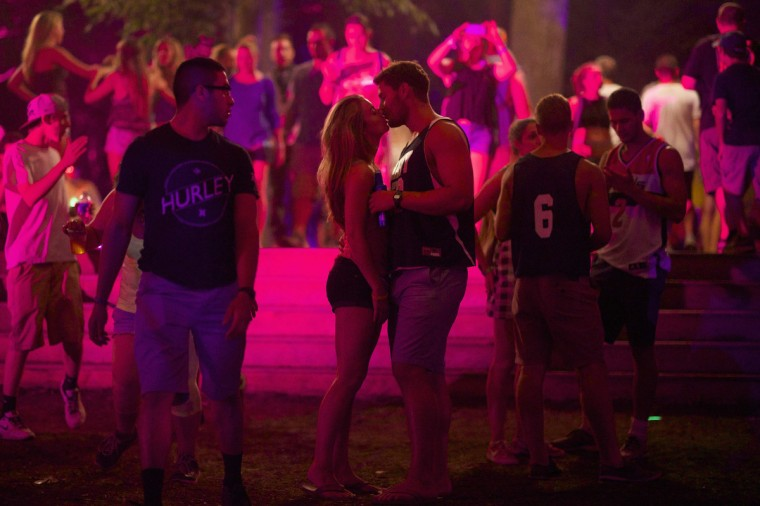 A couple kisses during the Firefly Music Festival in Dover June 21, 2014. The four-day festival is set at the 105 acre grounds on the Dover International Speedway where many well known bands will perform. (Mark Makela/Reuters)