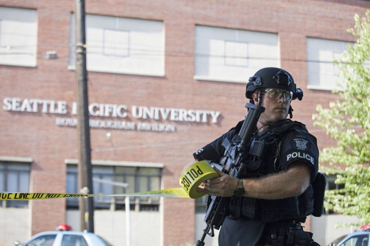 A policeman secures the scene at Seattle Pacific University after the campus was evacuated due to a shooting in Seattle, Washington June 5, 2014. A gunman opened fire on Thursday on the campus of a small Christian college in Seattle, killing one person and wounding at least three others before he was subdued by school staff and arrested, Seattle police and hospital officials said. (David Ryder/Reuters)