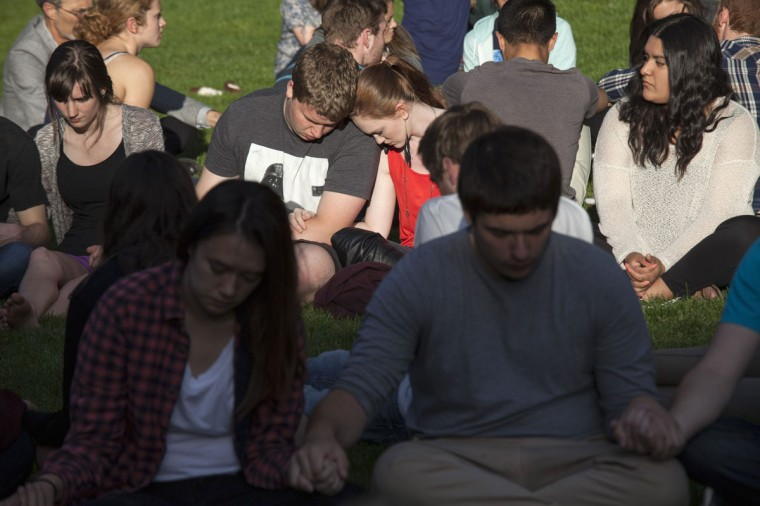 Students pray together after a shooting on campus at Seattle Pacific University in Washington June 5, 2014. A man armed with a shotgun opened fire on Thursday at a small Christian college in Seattle, killing one person and wounding three others before he was subdued by a group of students and arrested, Seattle police and hospital officials said. (David Ryder/Reuters)