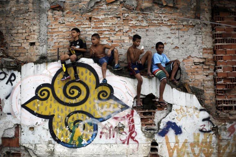 "Children watch a soccer match held by activists as part of the ""Rebel Cup"" in downtown Sao Paulo. (REUTERS/Nacho Doce)"