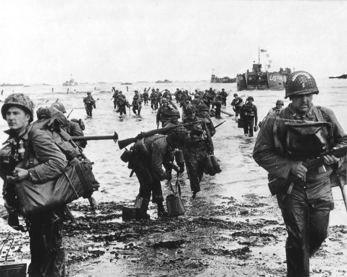 U.S. reinforcements land on Omaha beach during the Normandy D-Day landings near Vierville sur Mer, France, on June 6, 1944 in this handout photo provided by the US National Archives. (Cpt Herman Wall/US National Archives//via Reuters)