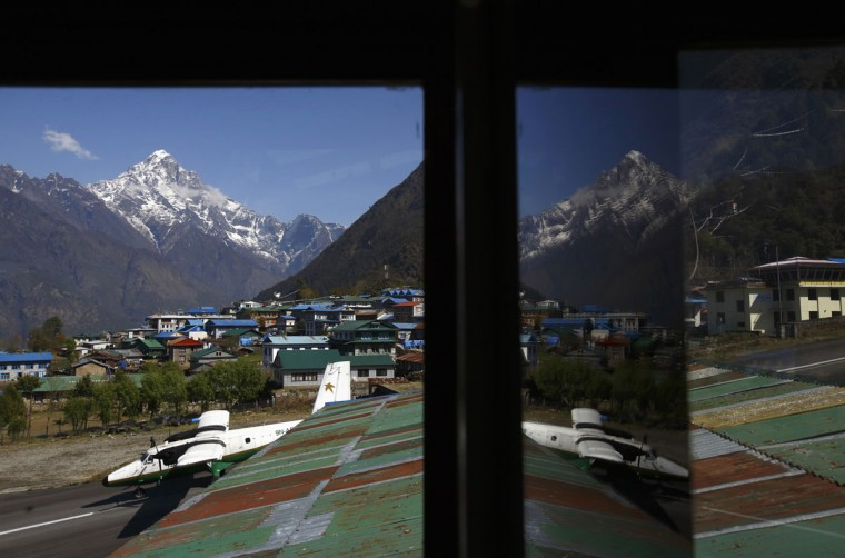 An aircraft is reflected in a mirror at a hotel as it takes off from Tenzing Hillary Airport, which has a reputation as the world's most dangerous airport in Lukla, approximately 2,800 meters above sea level in the Solukhumbu district. (REUTERS/Navesh Chitrakar)