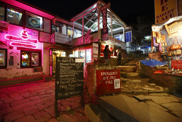 Lights illuminate a street in the evening in Namche, approximately 3,440 meters above sea level in the Solukhumbu District. (REUTERS/Navesh Chitrakar)