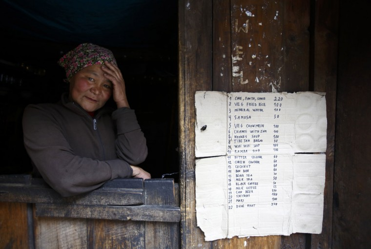 A woman sits in the window of her shop on the way to Namche in the Solukhumbu District. (REUTERS/Navesh Chitrakar)