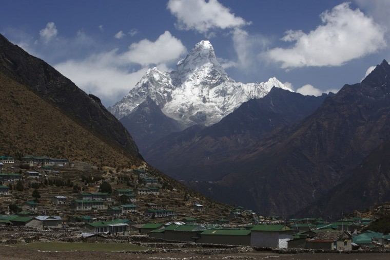 Mount Ama Dablam, which stands approximately 6,800 meters above sea level, is seen behind Khumjung Village in the Solukhumbu District on April 30, 2014. (REUTERS/Navesh Chitrakar)