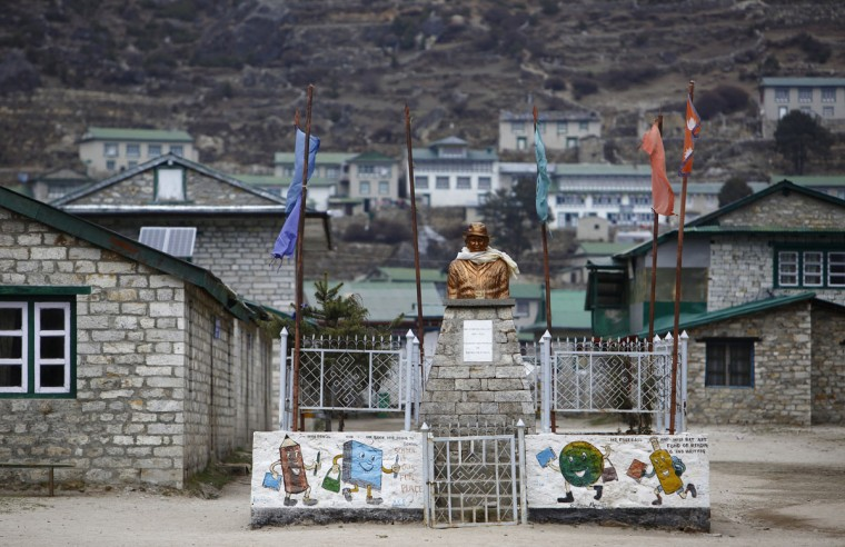 A statue of Sir Edmund Hillary, one of the first climbers to reach the summit of Mount Everest and the founder of Khumjung High School, is seen in the school grounds in Khumjung, approximately 3,700 meters above sea level in the Solukhumbu District on May 8, 2014. (REUTERS/Navesh Chitrakar)