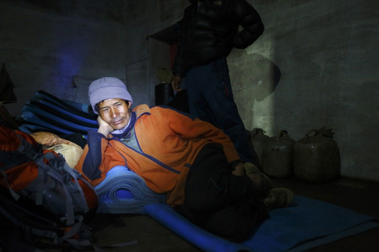 A porter rests inside a porterhouse in Tengboche, approximately 3,800 meters above sea level, in Solukhumbu District on May 1, 2014. (REUTERS/Navesh Chitrakar)