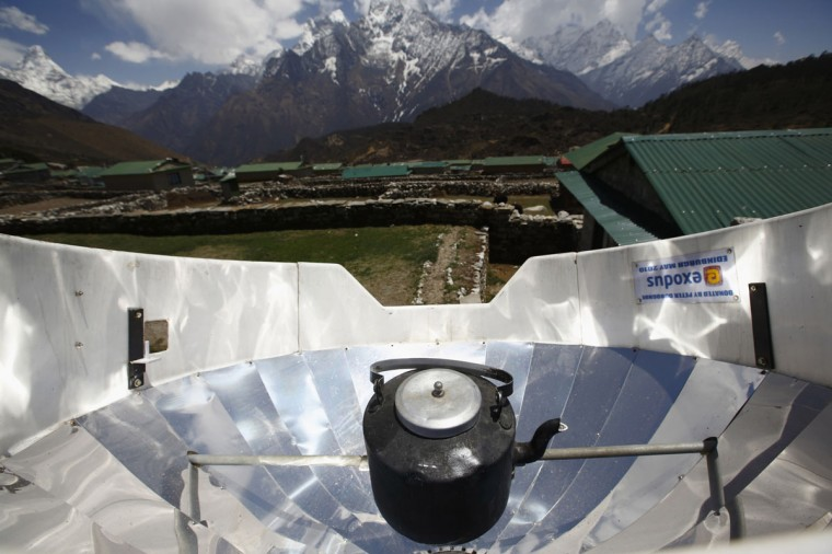 Water is boiled using solar power in Khumjung, approximately 3,700 meters above sea level in Solukhumbu District on April 30, 2014. (REUTERS/Navesh Chitrakar)
