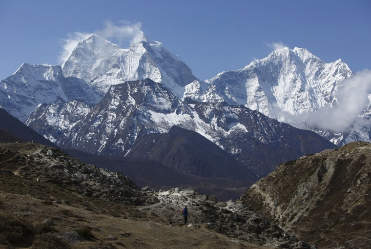 A trekker walks in front of Mount Thamserku while on his way back from Everest base camp near Pheriche in the Solukhumbu District on May 3, 2014. (REUTERS/Navesh Chitrakar)